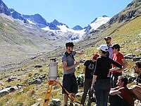 group of people researching on a glacier